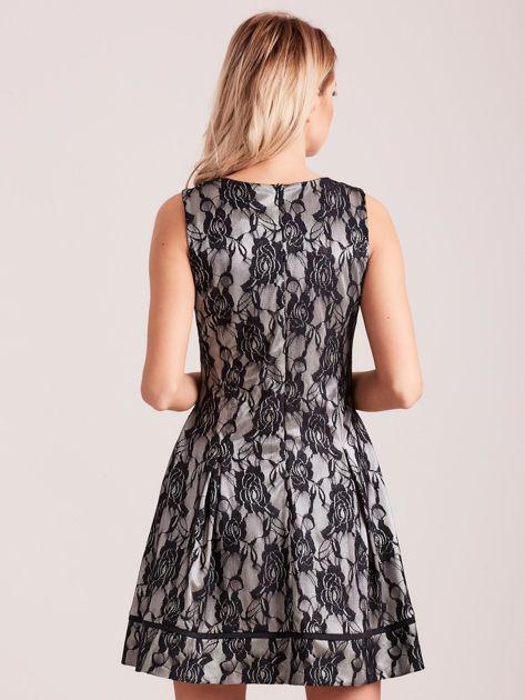 Koronkowa rozkloszowana sukienka czarna                              zdj.                              2