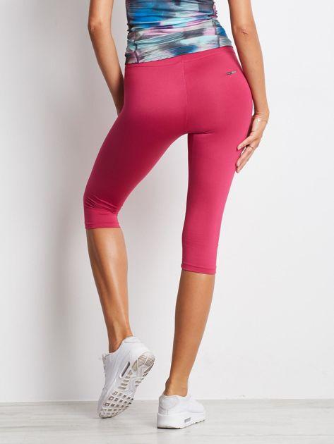 Krótkie lekko ocieplane legginsy fitness ciemnofuksjowe                              zdj.                              2