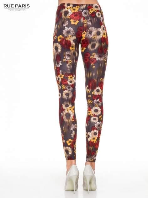 Kwiatowe legginsy w kolorze brązowym                                  zdj.                                  4