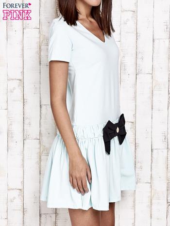 Miętowa sukienka dresowa z kokardą z przodu                                  zdj.                                  3