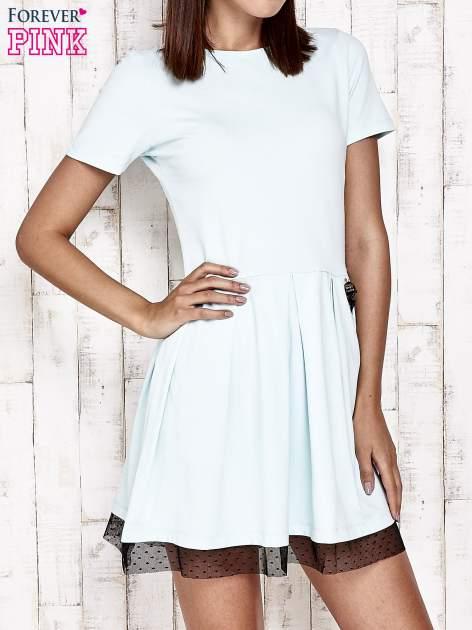 Miętowa sukienka dresowa z tiulem w groszki