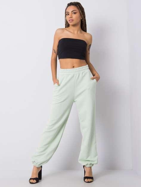 Miętowe spodnie dresowe Kyana RUE PARIS