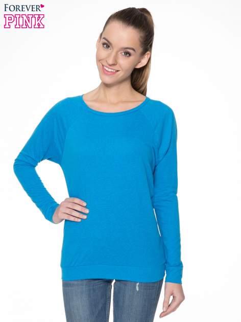 Niebieska bawełniana bluzka z rękawami typu reglan