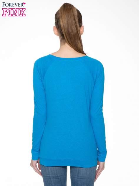 Niebieska bawełniana bluzka z rękawami typu reglan                                  zdj.                                  6