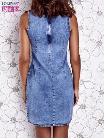 Niebieska jeansowa sukienka z wycięciami                                  zdj.                                  5