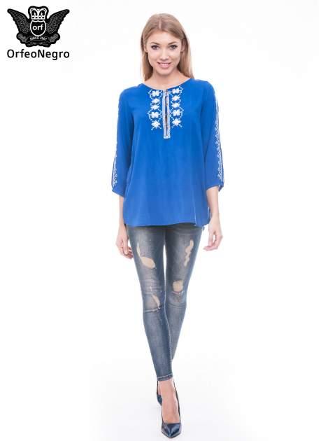 Niebieska luźna koszula z haftem                                  zdj.                                  2