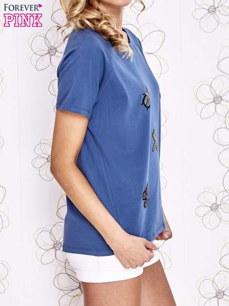 Niebieski t-shirt z aplikacją owadów                                   zdj.                                  3
