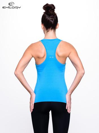 Niebieski top fitness z dekoltem V                                  zdj.                                  3