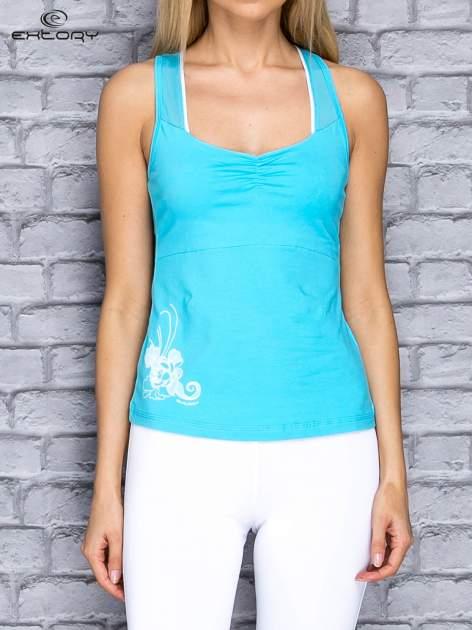 Niebieski top sportowy z siateczką i nadrukiem floral print                                  zdj.                                  1