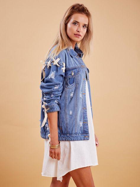 Niebieskie jeansowa kurtka z przedarciami                               zdj.                              3