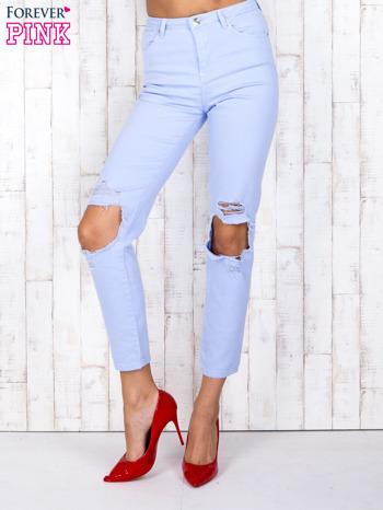 Niebieskie jeansowe spodnie z dziurami i kieszeniami                                  zdj.                                  1