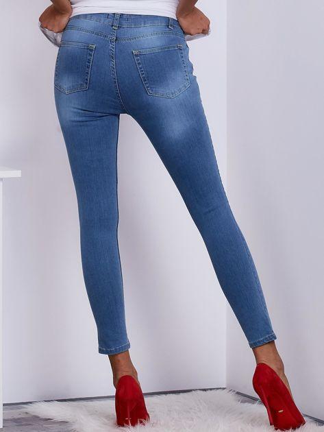 Niebieskie jeansy rurki z wysokim stanem                               zdj.                              2