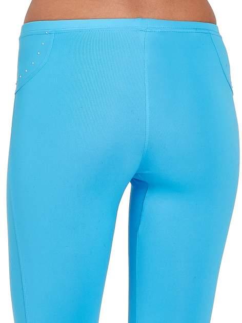 Niebieskie legginsy sportowe termalne z dżetami i ściągaczem                                  zdj.                                  4