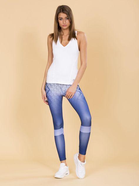 Niebieskie legginsy we wzory                              zdj.                              4