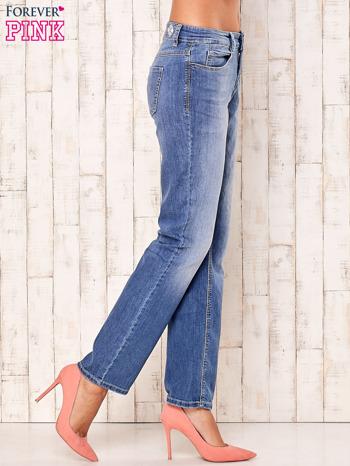 Niebieskie proste przecierane spodnie                                  zdj.                                  3