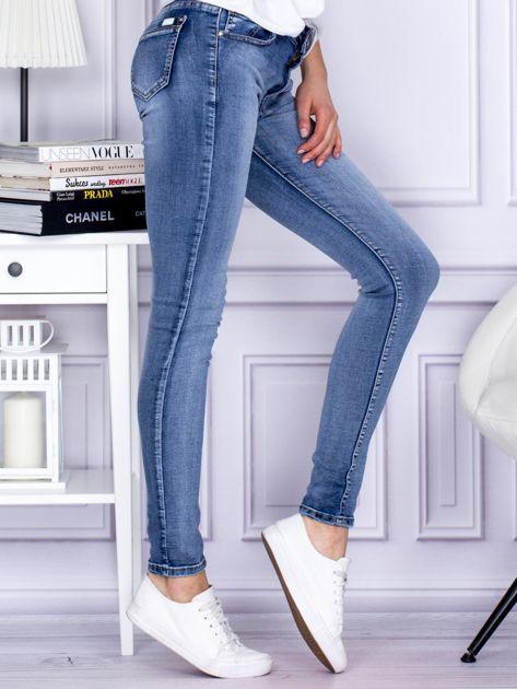 Niebieskie rozjaśniane jeansy rurki                                  zdj.                                  5