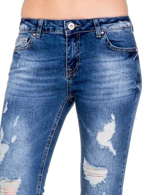 Niebieskie spodnie jeans 7/8 z dziurami i przetarciami                                  zdj.                                  6