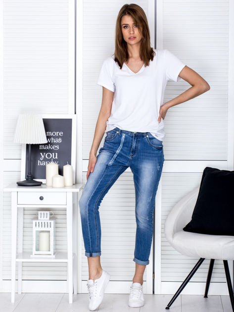 Niebieskie spodnie jeansowe damskie z ozdobnym suwakiem PLUS SIZE                                  zdj.                                  4