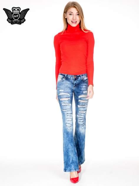 Niebieskie spodnie jeansowe dzwony z rozdarciami cut out                                  zdj.                                  4
