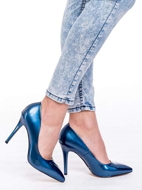 Niebieskie spodnie jeansowe marmurki z wysokim stanem                                  zdj.                                  7