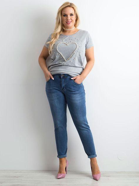 Niebieskie spodnie jeansowe rurki PLUS SIZE                              zdj.                              4