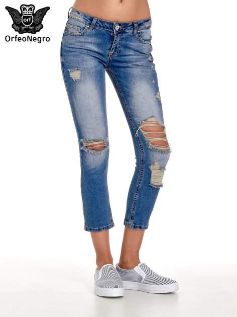 Niebieskie spodnie jeansowe skinny 7/8 z dziuarmi na kolanach                                  zdj.                                  1
