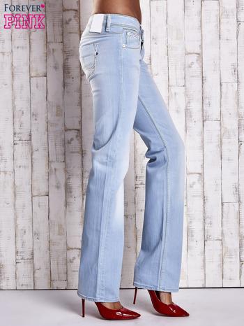 Niebieskie spodnie jeansowe z prostą nogawką                                  zdj.                                  3