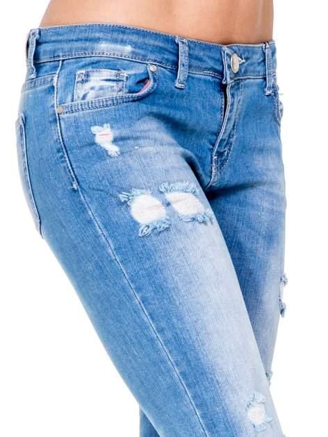 Niebieskie spodnie skinny jeans 7/8 z dziurami i przetarciami                                  zdj.                                  6