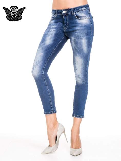 Niebieskie spodnie skinny jeans z cieniowaniem i przetarciami z przodu                                  zdj.                                  1