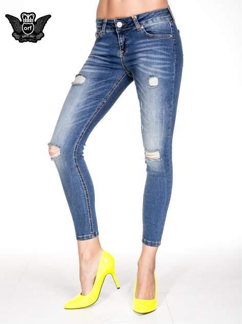 Niebieskie spodnie skinny jeans z dziurami z przodu                                  zdj.                                  1