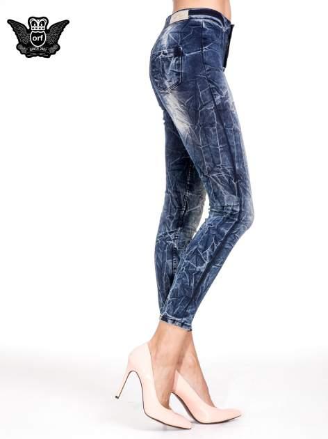 Niebieskie spodnie skinny jeans z efektem destroyed                                  zdj.                                  3