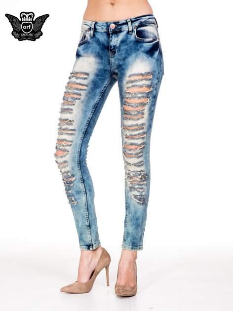 Niebieskie spodnie skinny jeansy z rozdarciami typu cut out                                  zdj.                                  1