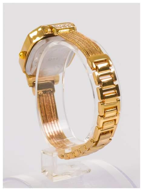 Ozdobny złoty damski zegarek z cyrkoniami na stalowej bransolecie z łańcuszkami                                  zdj.                                  3