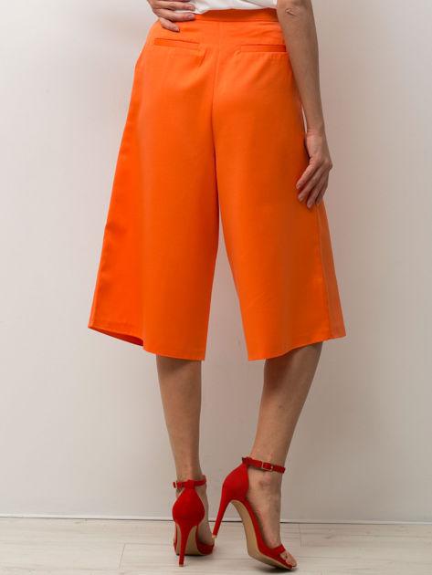Pomarańczowe spódnicospodnie typu culottes                                  zdj.                                  4