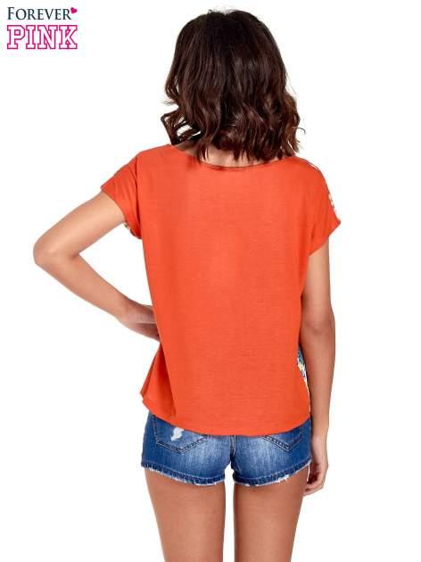 Pomarańczowy t-shirt z nadrukiem floral print                                  zdj.                                  4