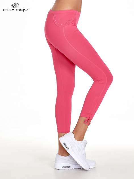 Różowe legginsy sportowe termalne z dżetami i ściągaczem                                  zdj.                                  2