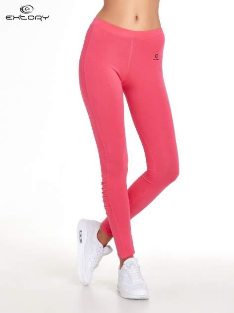 Różowe legginsy sportowe z drapowaniem                                  zdj.                                  1