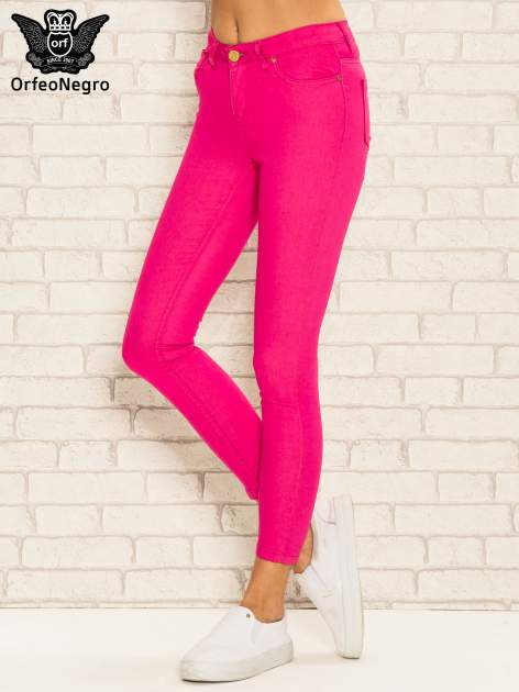 Różowe spodnie rurki skinny z kieszeniami