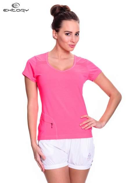Różowy t-shirt sportowy z kieszonką na suwak PLUS SIZE