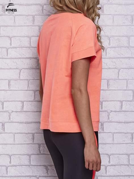 Różowy t-shirt z palmowym nadrukiem                                  zdj.                                  2