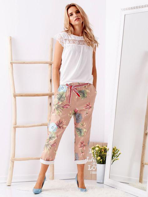 Beżowe spodnie w kwiaty                              zdj.                              1