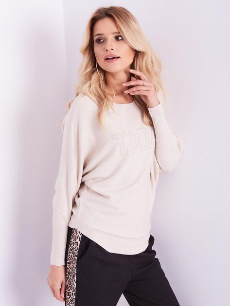 SCANDEZZA Beżowy sweter oversize z błyszczącym napisem                              zdj.                              5