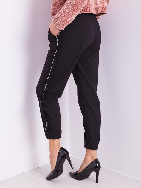 SCANDEZZA Czarne luźne spodnie z falbankami                              zdj.                              10