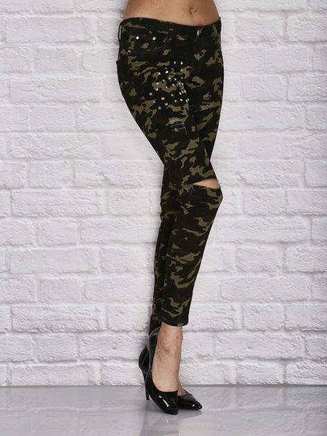 Spodnie damskie rurki w moro wzór z dziurami i ćwiekami zielone