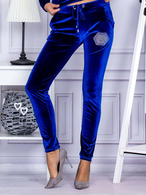 Spodnie dresowe welurowe z błyszczącymi kamyczkami niebieskie                              zdj.                              1