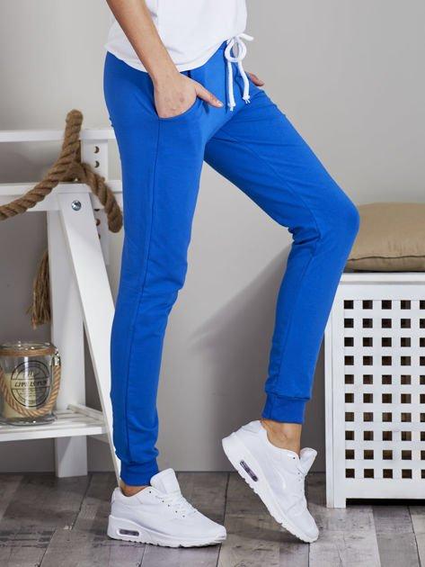Spodnie dresowe ze ściągaczami i troczkami niebieskie                              zdj.                              5