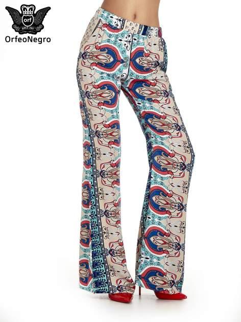 Spodnie dzwony we wzór ornamentowy                                  zdj.                                  1
