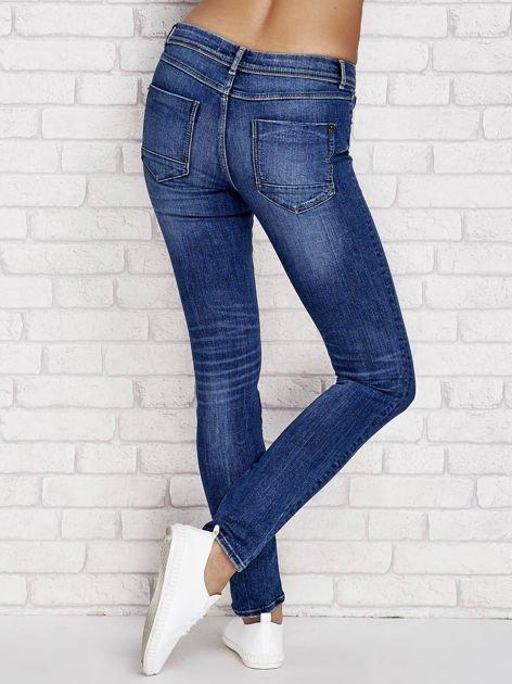 Spodnie jeansowe regular z przetarciami jasnoniebieskie