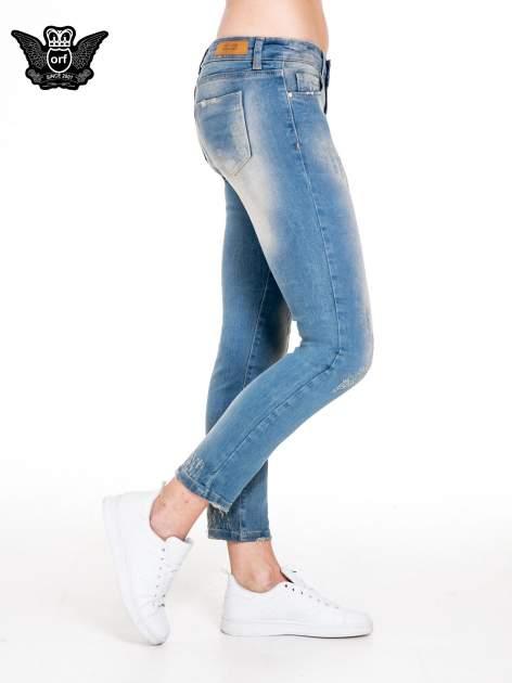 Spodnie jeansowe rurki z pionowymi przetarciami                                  zdj.                                  3