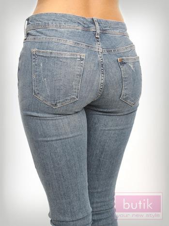 Spodnie jeasnowe z przetarciami                                  zdj.                                  4